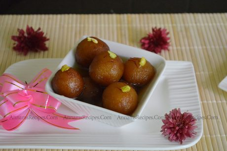 Paneer Jamun Recipe Gulab Jamun with Paneer For this Diwali I decided to try paneer jamun. So I googled it and got the recipe. I tried. It Came out very well and I felt so happy. Now let us see how to make Gulab Jamun With Paneer Ingredients: Paneer - 1 cup Maida - 1 tablsp Cooking soda - 2 pinch Oil - to deep fry Ghee - 2 tsp Pistachio - 10 for garnishing For Sugar Syrup Sugar - 1 cup (250 ml Cup) Water - 1 cup Rose essence - few drops Saffron - few strands Method: Add Paneer, cooking soda and maida in a bowl and knead to a smooth dough. Then make small lemon size balls out of it. Same time make the sugar syrup. Add sugar, Saffron and water in a vessel and boil for about 20 minutes( no string consistency). Heat oil and ghee in a frying pan. Don't heat the oil more. Low the flame and fry all the jamun in batches. Cook all the sides golden brown colour. Stir often. Add fried jamun in the hot sugar syrup. Note: Don't knead the dough more. If you knead more the outer layer will be hard. Knead smoothly. If you want to make Paneer, you can use one litre full fat milk. It will give 1 cup Paneer. Fry 5 to 6 jamun at a time. Don't put more. If you fry jamun in high flame outer layer gets cooked quickly, and the inner side will not be cooked. So fry it in the low flame.